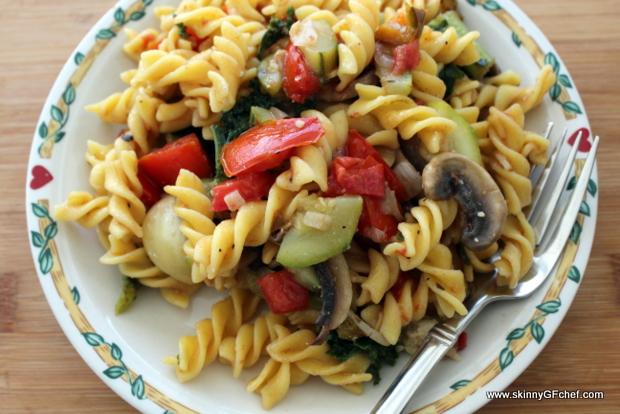 Warm Gluten-Free Pasta Salad with sauteed zucchini, kale, tomatoes and mushrooms