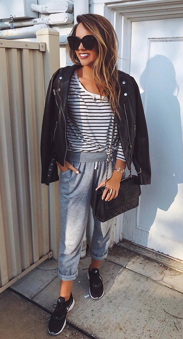 comfy outfit idea / grey pants + sneakers + bag + moto jacket + striped top