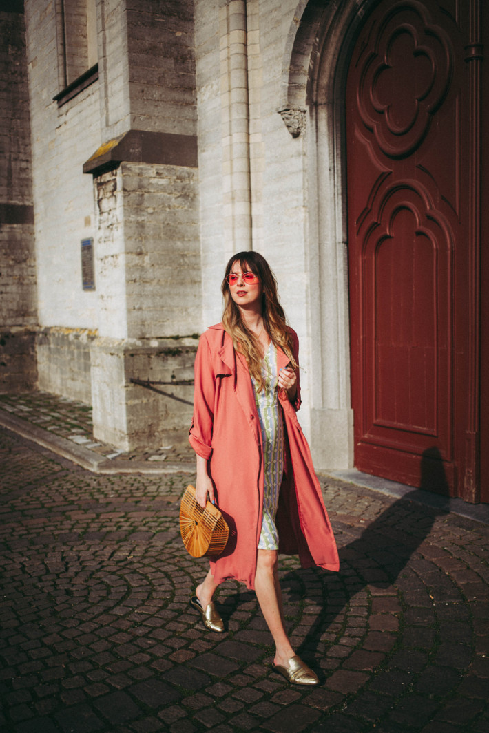 Outfit: wiggle dress, pink trench, slip on loafers and bamboo bag