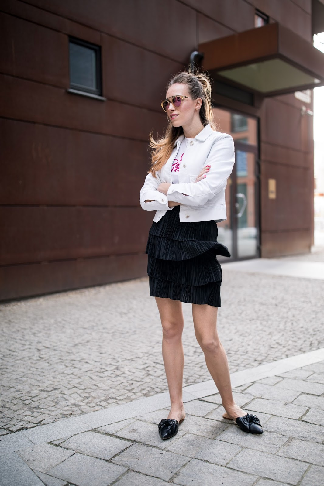 black mini skirt mule loafers outfit