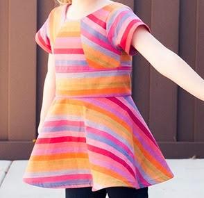 http://shwinandshwin.com/2014/11/rainbow-pieced-peplum-free-pattern.html