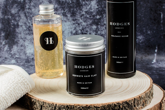 Premium looking mens toiletries samples from Hodges London including Volcanic Scrub, reggie's hair clay and shampoo