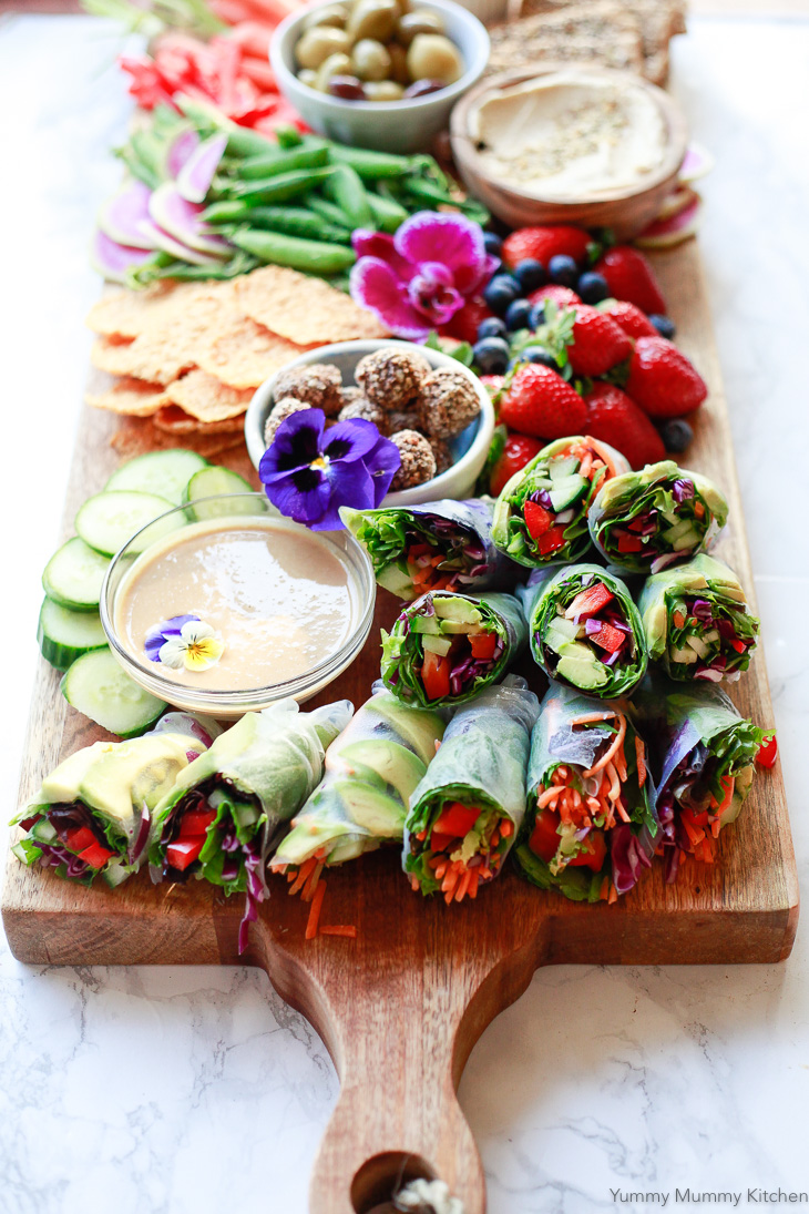 Colorful fresh homemade spring rolls served with peanut sauce are perfect on a party platter, for lunch, or a light dinner.