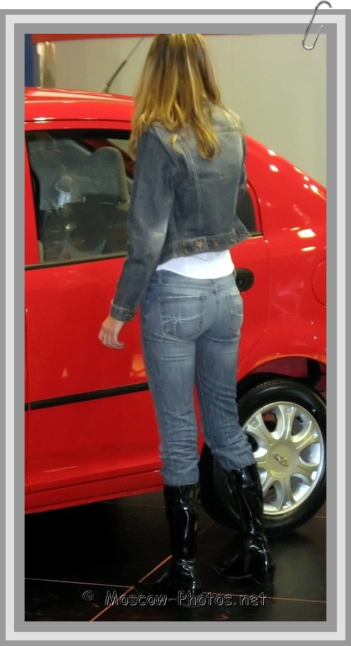 Moscow Girl in Denim Suit Washing a Car