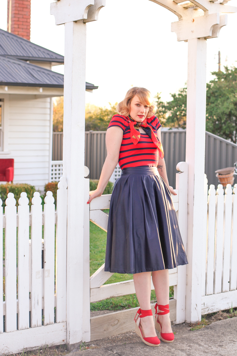 @findingfemme rides a Lekker Bike in Review Australia striped top and navy midi skirt.