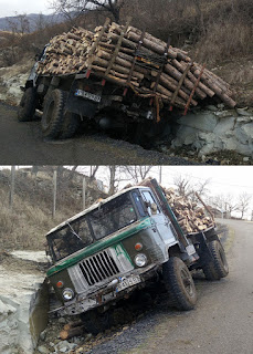 Logging truck in the ditch