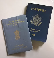"A US Passport with an Indian ""Permanent Resident Card"" known as an Overseas Citizen of India (OCI) card."