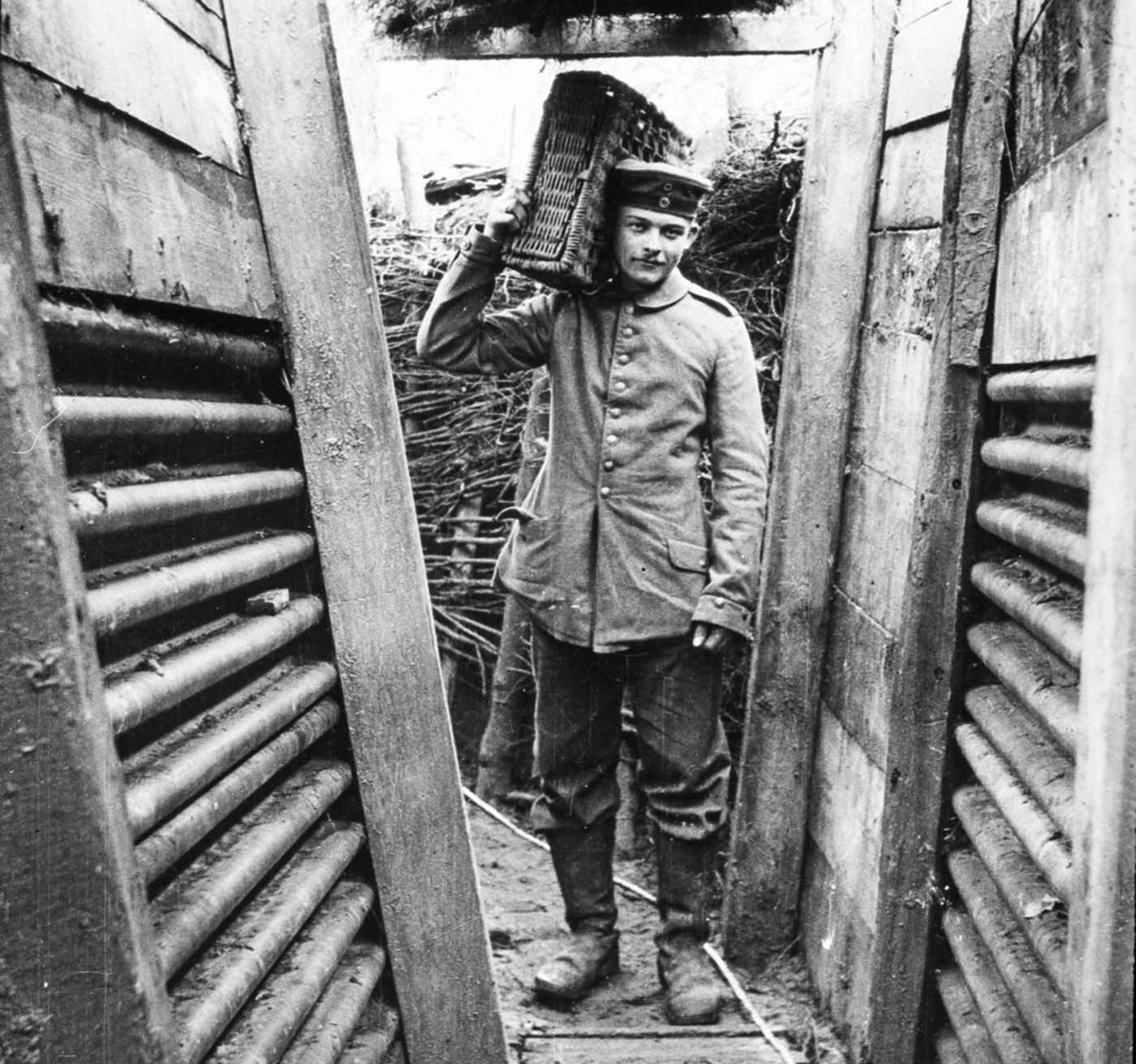 Walter Kleinfeldt, pictured carrying ammunition in a Somme trench, joined a German gun crew in 1915 and fought at the Somme aged just 16, taking pictures of life on the frontline with his Contessa camera.