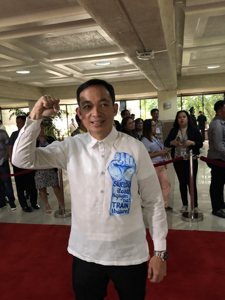 ACT Party-list Rep. Antonio Tinio printed his protest message in his Barong Tagalog