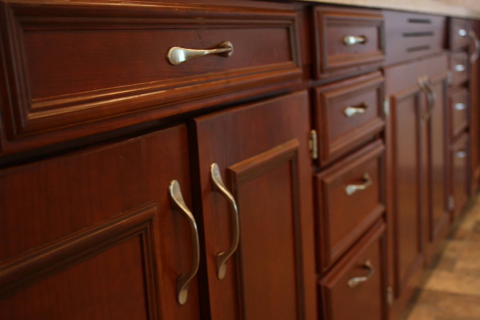 closeup of some refinished 1920s cabinets. They are original to the