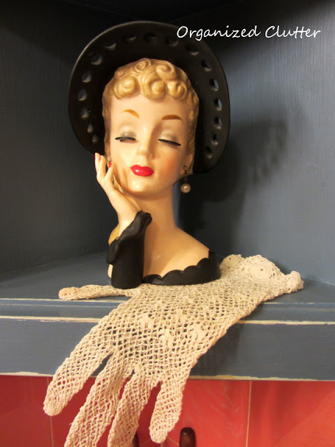 Headvase with glove as a doily