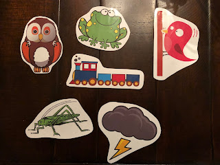 laminated owl, frog, woodpecker, train, grasshopper, and storm cloud shapes
