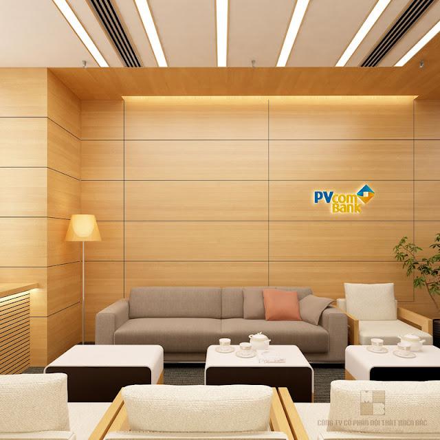 Thiết kế nội thất phòng họp trở nên sang trọng tuyệt đối và tạo ấn tượng dễ nhớ với các mảng chất liệu trang trí từ gỗ công nghiệp màu vàng nhẹ nổi bật logo thương hiệu của ngân hàng Pvcom bank