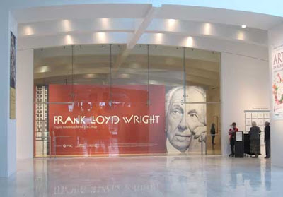 Frank Lloyd Wright's picture across a large white space