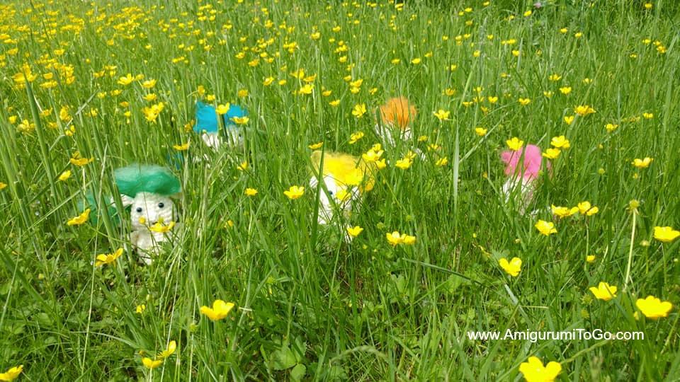 crochet trolls in the grass