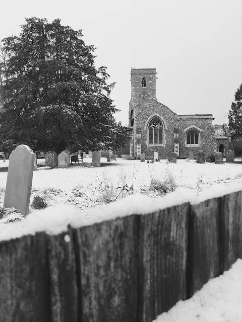 Snowy Church in rural England UK Black and white, mono