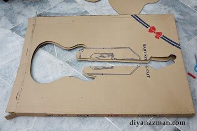 Como hacer una guitarra de cartón eléctrica.