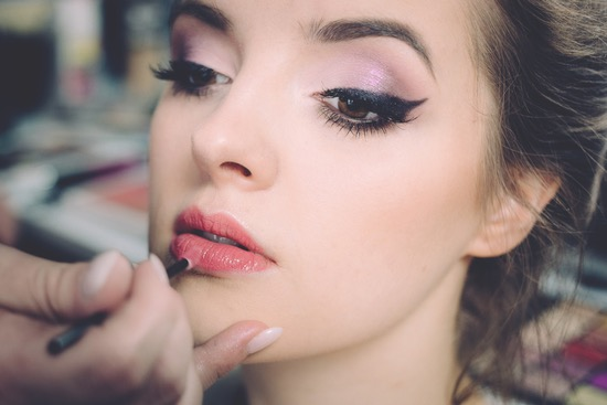 puttling a lipstick, woman