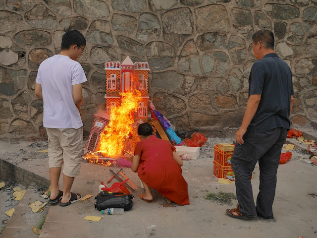 paper house burning for the Hungry Ghost Festival