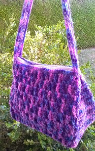 http://www.ravelry.com/patterns/library/orchard-mist-purse