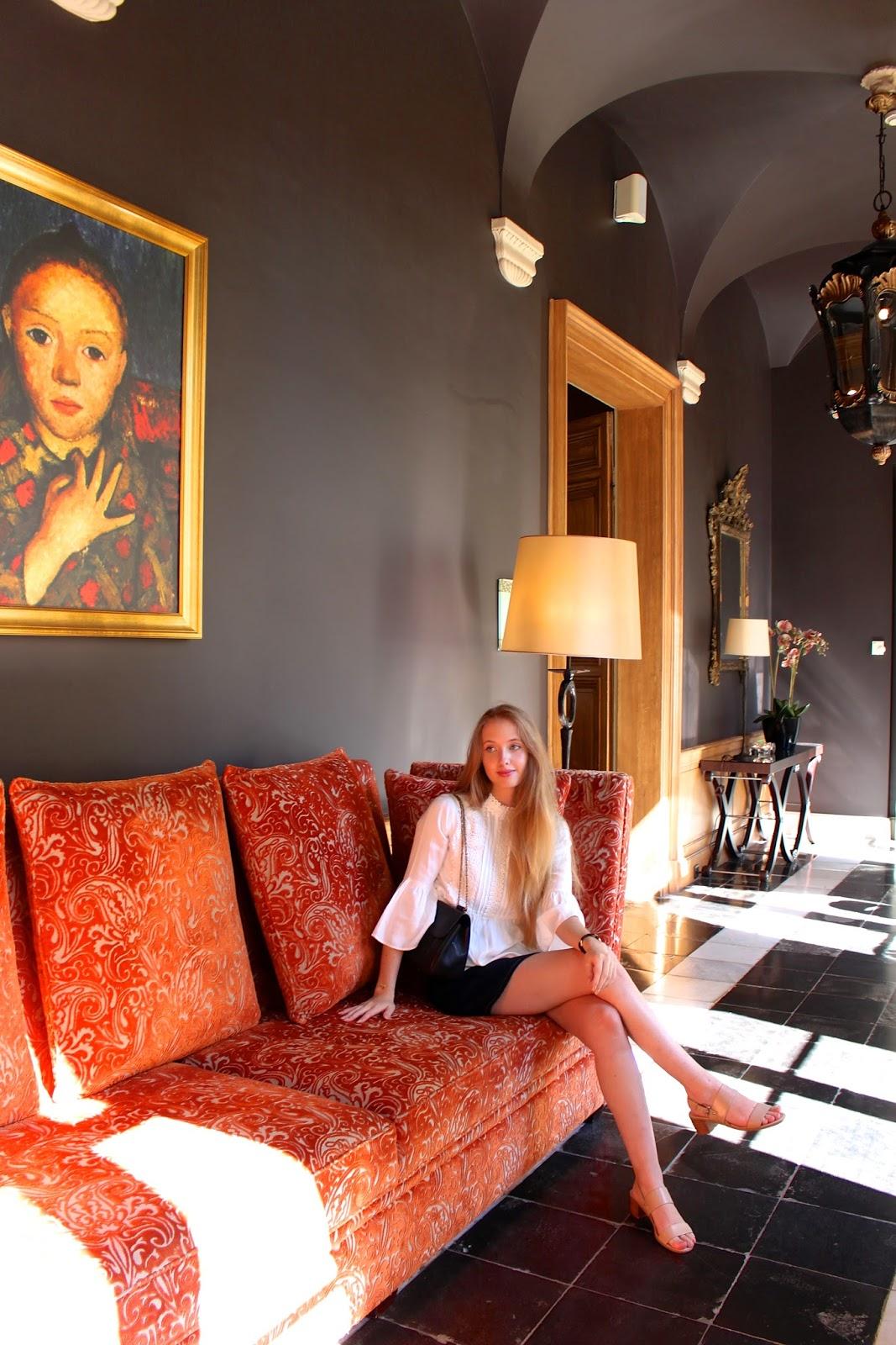 Luxury travel blogger exploring Hotel Dukes' Palace