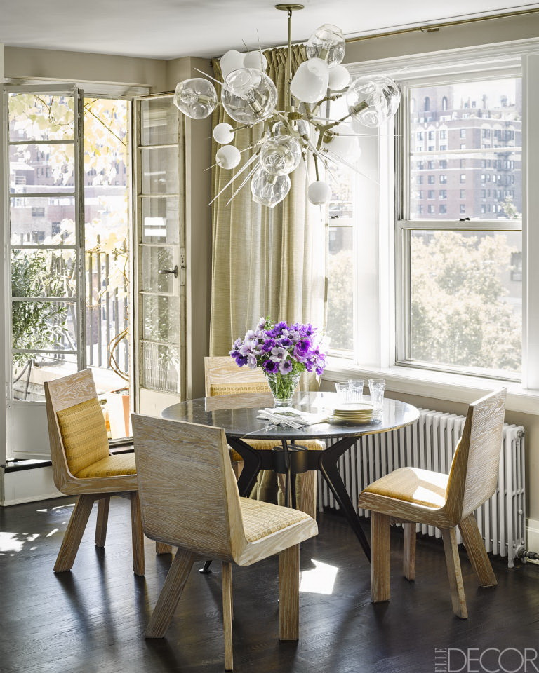 Chairs From HousingWorks Surround A Vintage Marble Topped Dining Table Found On EBay The Chandelier Is By Lindsey Edelman And Curtains Are Of