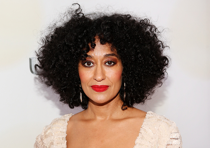 Image of hollywood actress tracee ellis ross with an afro, brown eye makeup and red lipstick