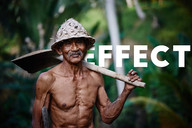 Elderly man holding a shovel