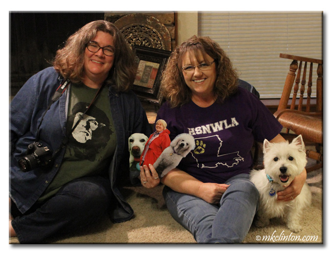 Two women and a Westie sitting on the floor