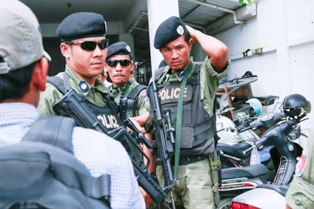 Police return empty handed after searching for deputy opposition leader Kem Sokha at the CNRP headquaters in Phnom Penh. Mr. Sokha is now a wanted man after he failed to show up at the Phnom Penh court for questioning. Pisith Heng