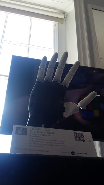 An artificial hand shown in an open pose, with fingers splayed.