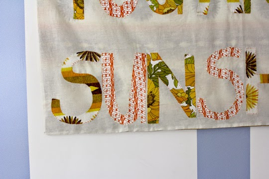 http://www.archieandtherug.com/2015/01/sunshine-wall-hanging.html how to make a graphic faric wall hanging
