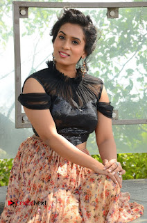 Actress Chetana Uttej Stills in Floral Long Skirt at Pichiga Nachav Movie Press Meet  0041.JPG