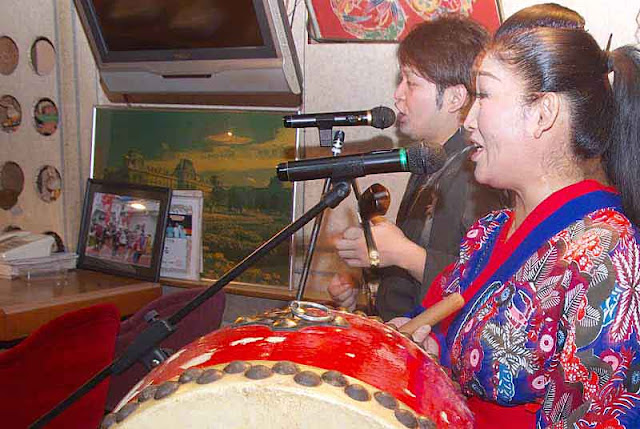 traditional music, sanshin, drum, man and woman, Mineo band