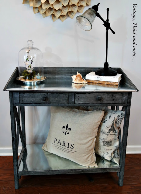 rustic potting table used in a vintage industrial decor shared at www.onemoretimeevents.com