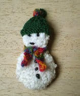 http://www.ravelry.com/patterns/library/advent-garland-16-snowman