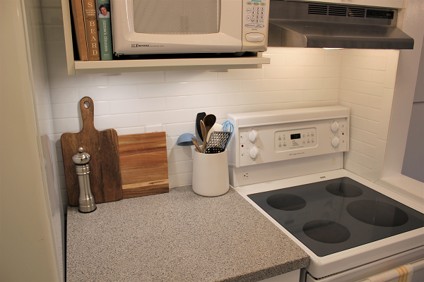 White kitchen with wood cutting boards