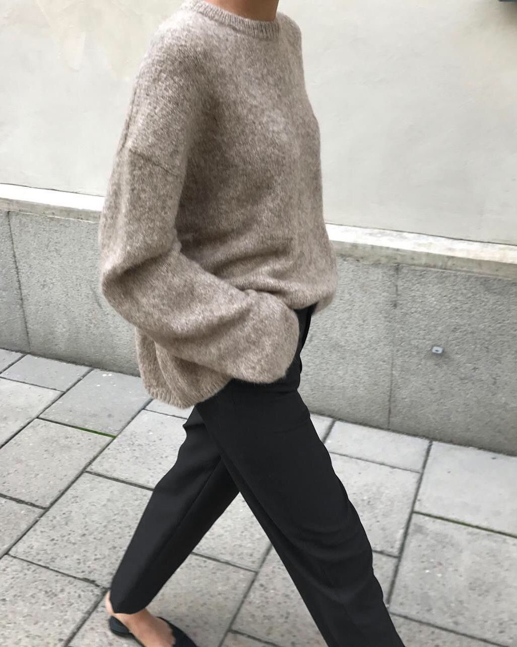 Easy Minimalist Instagram Outfit Idea: Neutral Oversized Sweater, Black Pants, and Mule Flats
