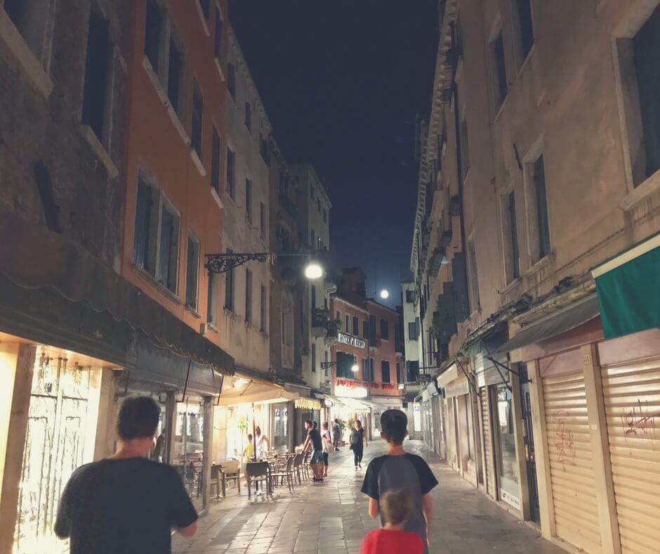 night photo of shops in Venice