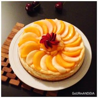 image Cheesecake vanillé aux pêches et spéculoos