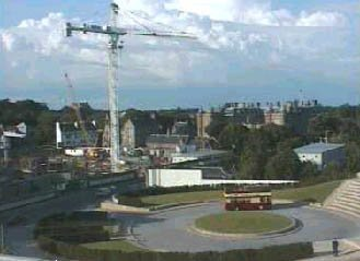 image of Iain in the distance near the Parliament building while under construction