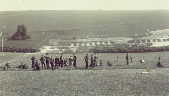 Photograph of Winchester not a WW1 range as such, but showing all the right features, i.e. the lower mantlet behind which the targets are raised, behind that, the backstop, which here is part of the slope of the hill - image from Peter Miller's collection