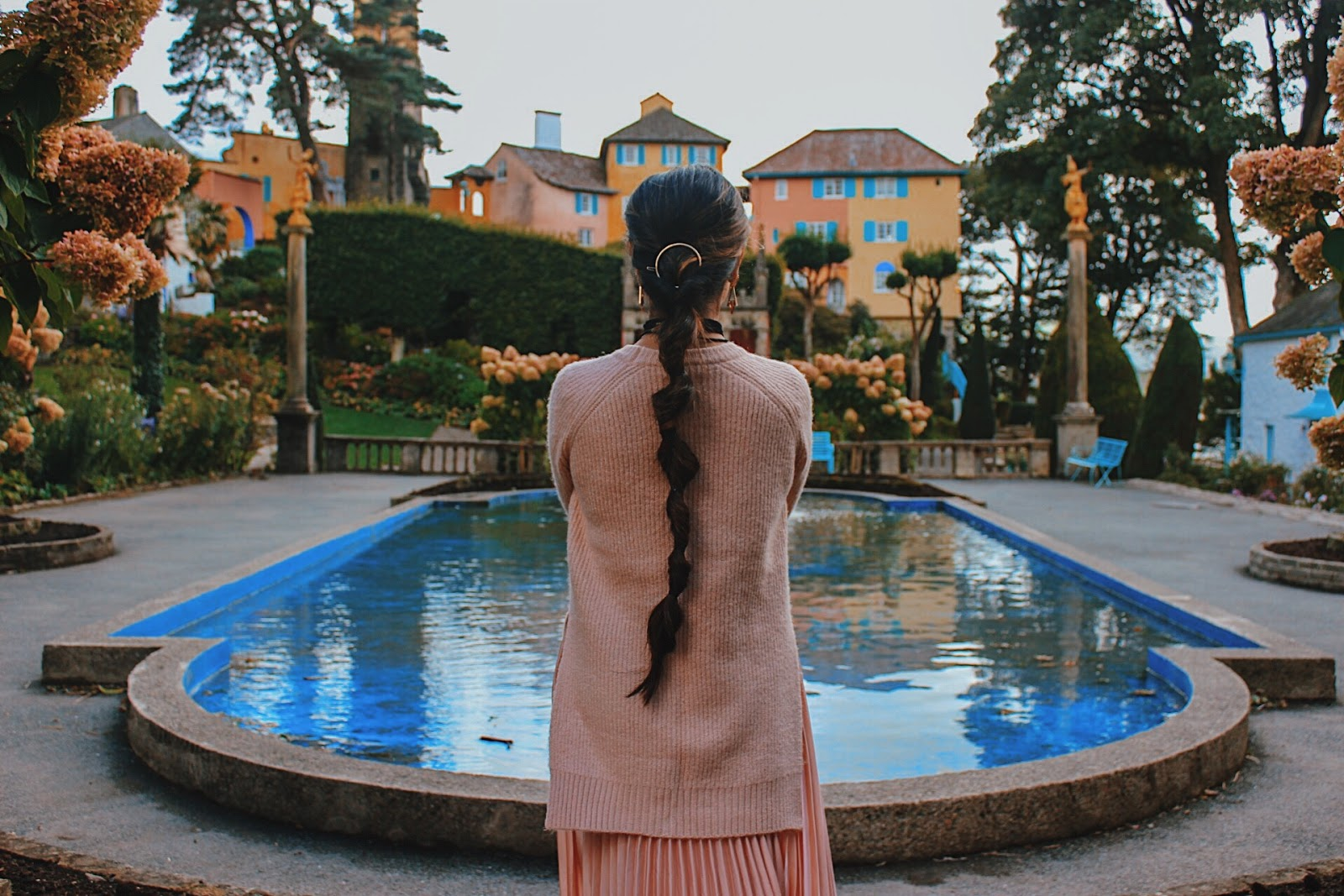 portmeirion wales, seaside places to visit uk, most beautiful village uk, must visit place uk, colourful village uk, indian blogger, london blog, uk travel blogger, all pink look, pink pleated skirt, pale pink outfit, millenial pink outfit, valentines day outfit