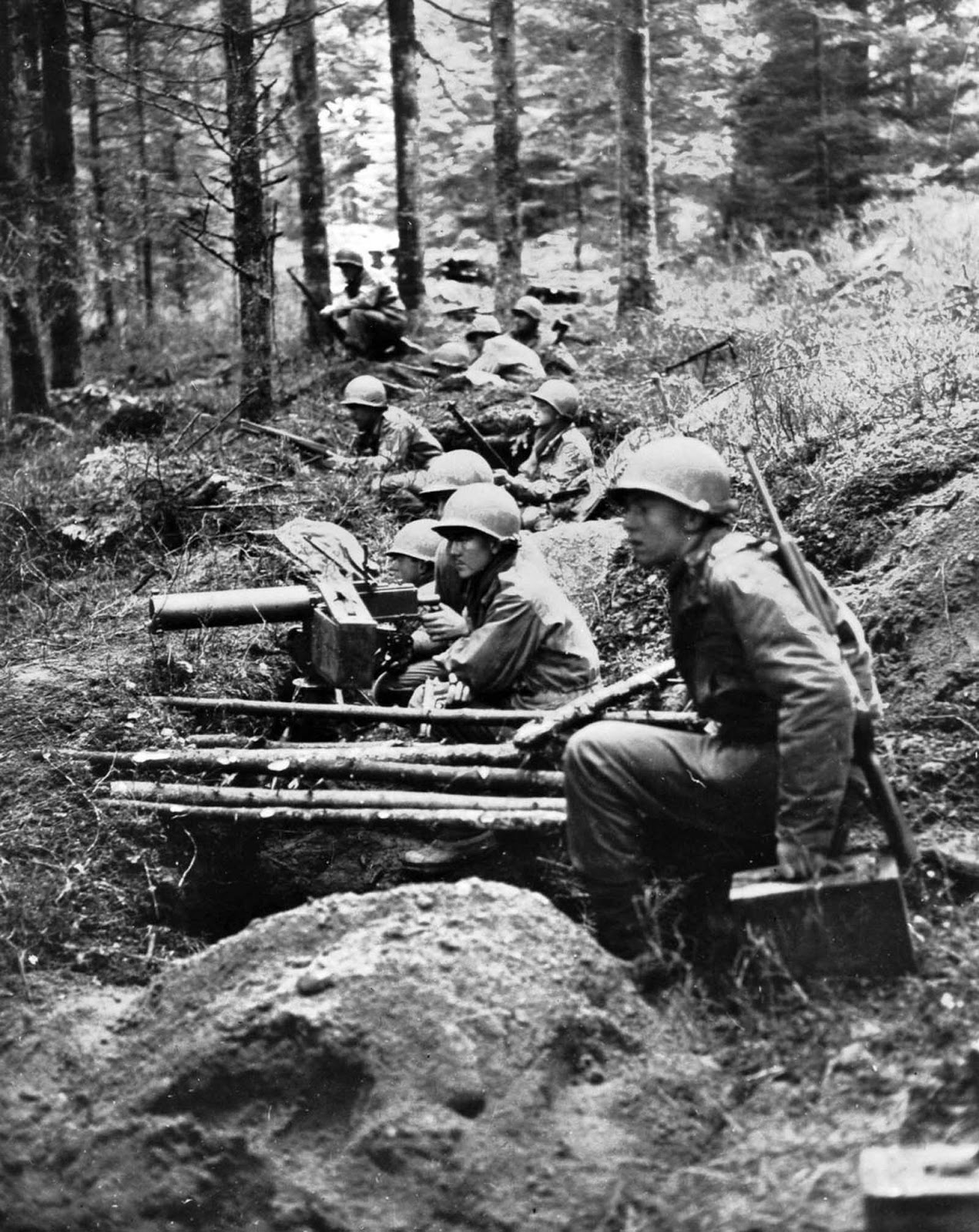Soldiers man a machine gun nest in eastern France. Sept. 1, 1944.