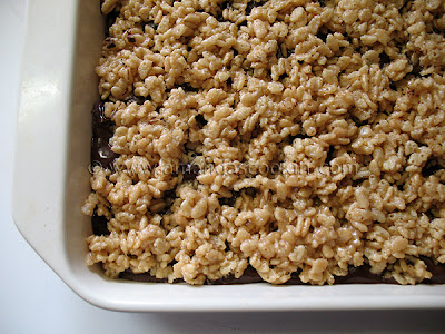 A close up photo of a pan of chewy cookie crunch bars.