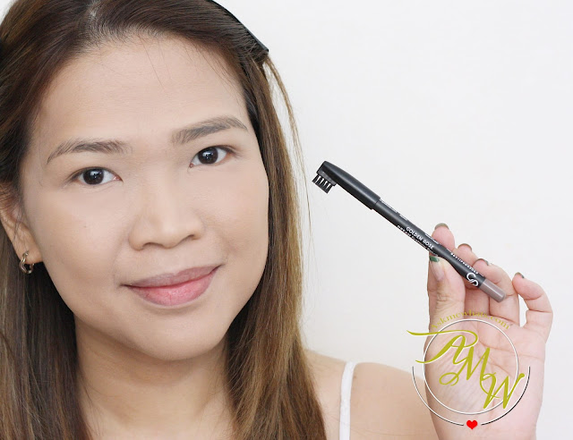 a photo of Nikki Tiu AskMeWhats holding Golden Rose Cosmetics Dream Eyebrow Pencil 306