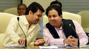 photo of anurag thakur and rajiv shukla sitting and talking