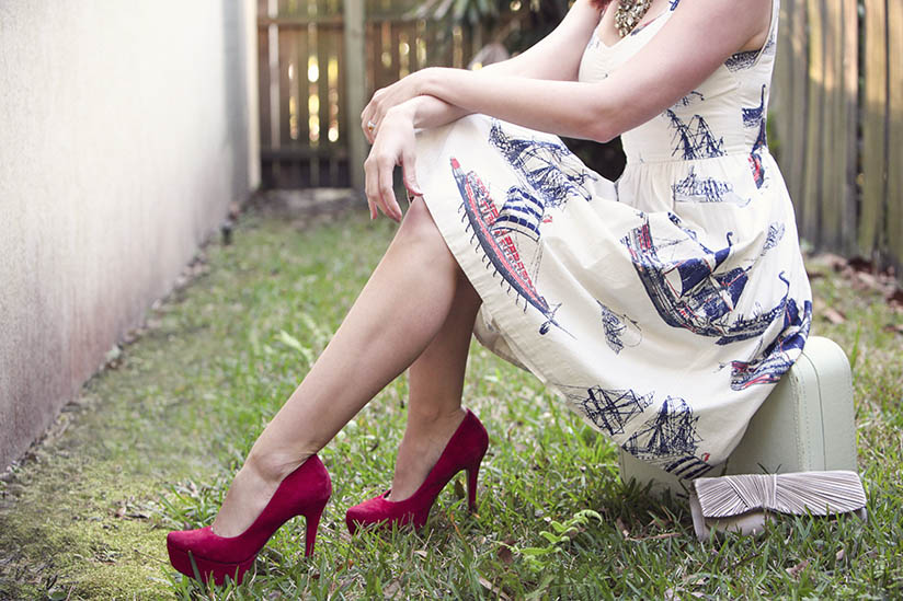 Red pumps with a casual dress