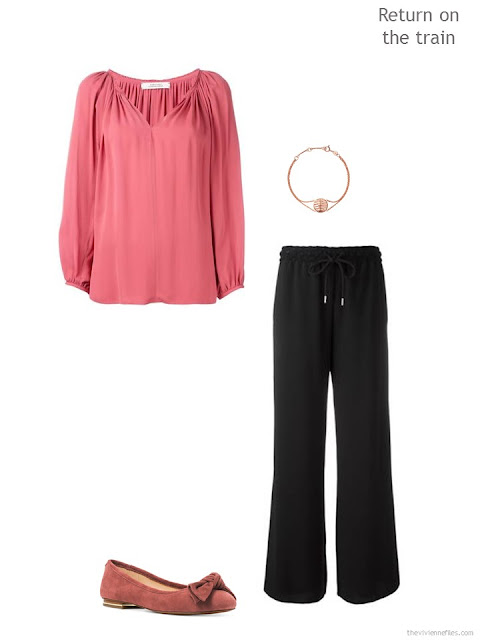 draped soft raspberry blouse with black pants and accessories