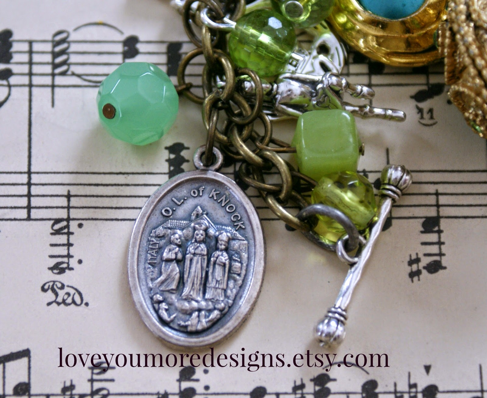 Our Lady of Knock medal on an Irish dance bracelet